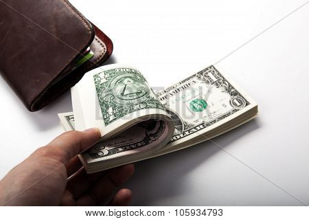 Hand Holds A Dollar Bill