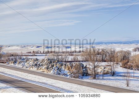 I-25 freeway in winter scenery at Natural Fort geological landmark in northern Colorado near Wyoming border