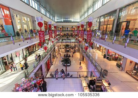 Dubai, Uae - October 07, 2014: Shoppers At Dubai Mall In Dubai, United Arab Emirates. Dubai Mall Is
