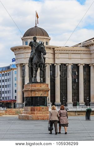 Skopje, Macedonia - April 3 2014: Statue of Goce Delchev Skopje with people passing by.