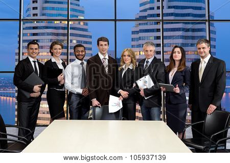Group of businessmen on the background of skyscrapers.