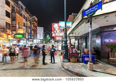 Bangkok, Thailand - April 17,2015: Unidentified Tourists Walking Along Khao San Road At Night, The M