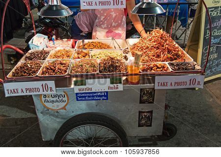 Bangkok, Thailand - April 17,2015: A Street Vendor Selling Fried Insects To Tourists On Khao San Roa
