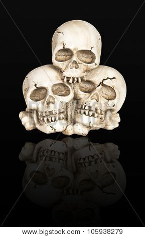 Cast of a weathered human skulls isolated over black