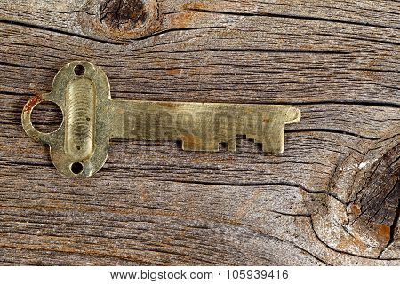 Vintage Key On Rustic Wood