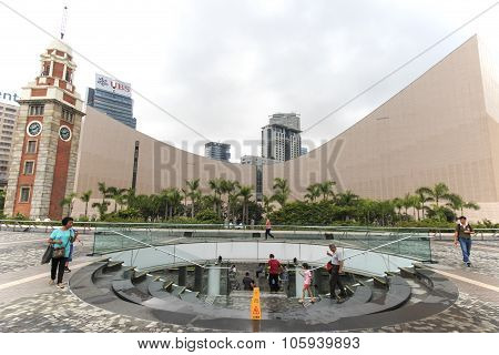 Kowloon, Hong Kong - August 14,2015: People Walking Near The Clock Tower, On The Southern Shore Of T
