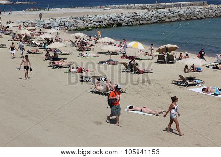 Barcelona - June 11: Crowded Beach With Tourists And Locals In S