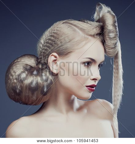 young elegant woman with creative hair style leopard print close up