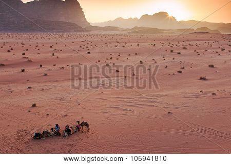 Wadi Rum, Jordan - March 24,2015: Sunset In The Wadi Rum Desert, Jordan, With Local Bedouins And Cam