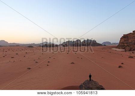 Wadi Rum, Jordan - March 24,2015: Sunset In The Wadi Rum Desert, Jordan, With A Man Watching The Sce