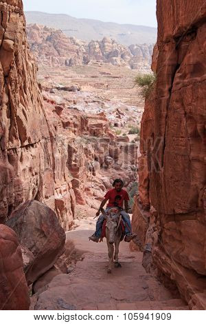 Petra, Jordan - March 26, 2015: Local Jordanin Guide Exploring The Ruins Of Ancient Petra, Jordan