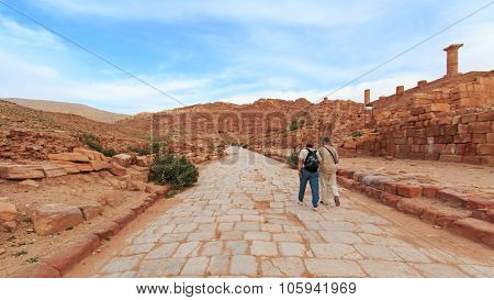 Petra, Jordan - March 26, 2015: Tourist Exploring The Ruins Of Ancient Petra, Jordan