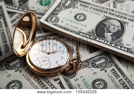Gold Watch And Dollar Bills