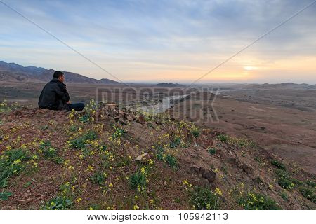 Feynan, Jordan - March 26,2015: Tourist Watching The Sunset From The Mountains In The Feynan Natural