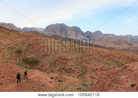 Feynan, Jordan - March 26,2015: Tourists Hiking The Mountains In The Feynan Natural Reserve In Jorda