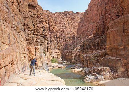 Wadi Al Mujib, Jordan - March 27,2015: Photographer In The Wadi Al Mujib