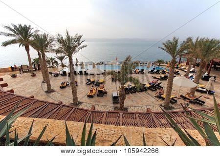 Dead Sea, Jordan - March 27, 2015: People Relaxing In The Dead Sea