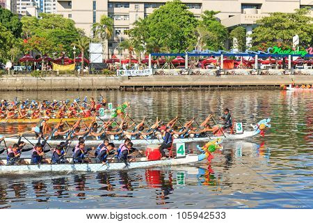 Boats racing in the Love River for the Dragon Boat Festival in Kaohsiung