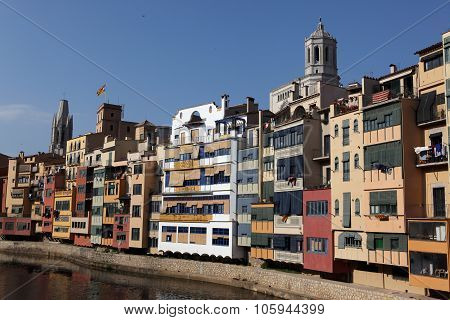 View Of The Old Town With Colorful Houses Reflected In Water Jewish Quarter In Girona. Catalonia.