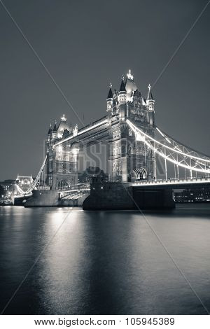 Tower Bridge in London in black and white at night.