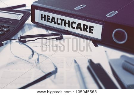 Healthcare on Ring Binder. Blured, Toned Image.