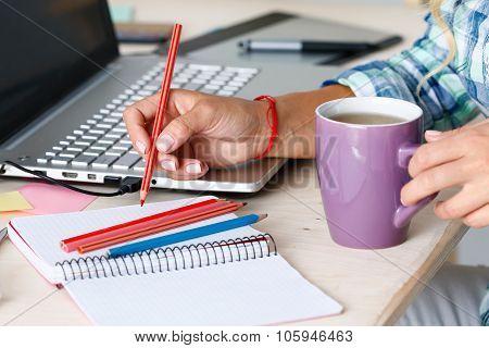 Female Designer Hands Holding Cup Of Hot Beverage