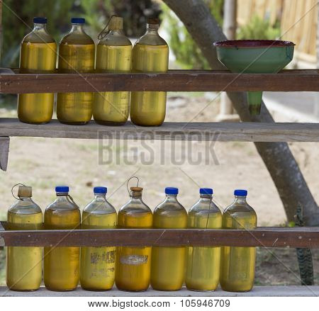 Gasoline For Motorbikes Sold From Whisky Bottles By A Roadside Vendor