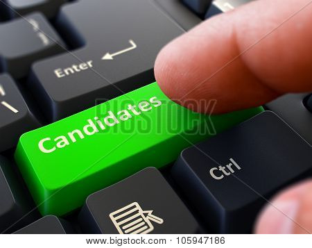 Pressing Green Button Candidates on Black Keyboard.