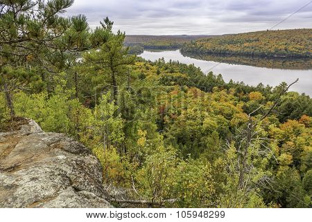 Precambrian Rock With Fall Colors And A Lake In The Background - Algonquin Provincial Park, Ontario,