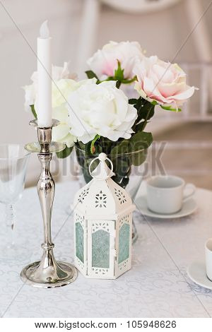 table with vase and  white candlestick