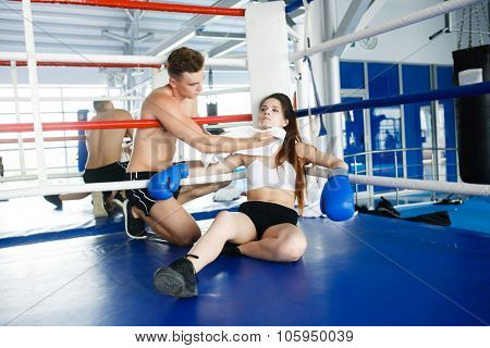 Man boxing coach trains woman athlete to play and pair
