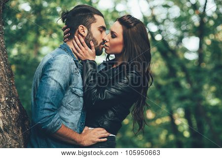 Beautiful Young Woman Kissing Handsome Man