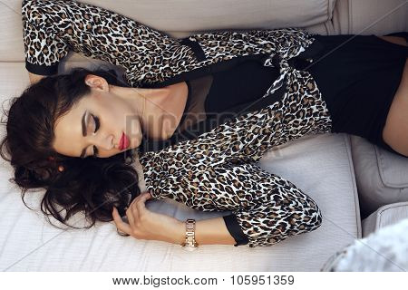 Sensual Woman With Dark Hair Wears Elegant Clothes