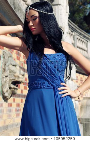 Gorgeous Woman With Dark Hair Wears Luxurious Dress And Bijou