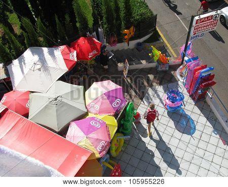 Aerial view of umbrellas souvenirs and boy