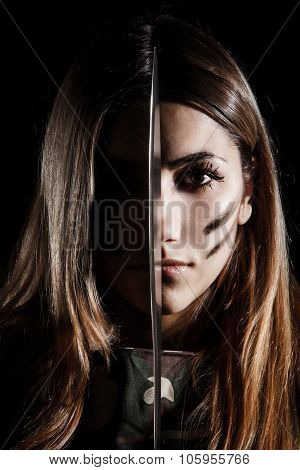 Woman Holding A Knife At The Middle Of Her Face