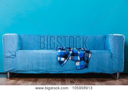 Checked Shirt On Sofa.
