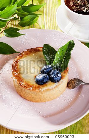 cake of semolina blueberry and mint on a gray plate Provence still life dessert