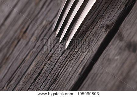 Metal Fork On Old Wooden Background
