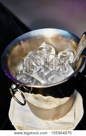 Close up ice in metal bucket