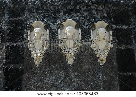 bas-reliefs of female figures