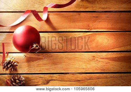 Ball Ribbon And Pinecone Christmas Decoration On Wooden Table Top