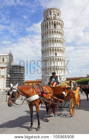 PISA, ITALY - September 03, 2014: Tourist carriage near Cathedral and the Leaning tower in Pisa