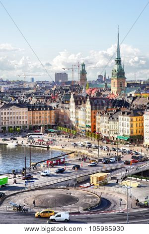 STOCKHOLM, SWEDEN - May 21, 2015: Old Town (Gamla Stan) in Stockholm and road traffic near Slussen subway stantion