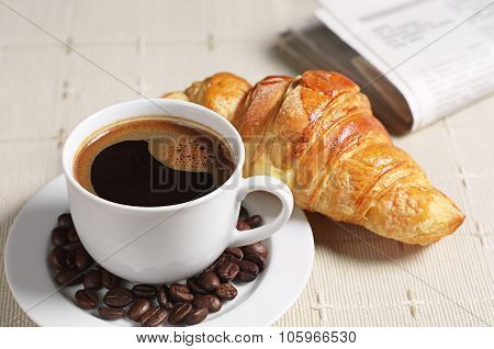 Coffee Croissant And Newspaper