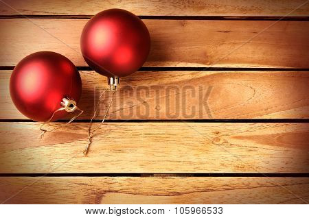 Two Red Balls Christmas Decoration On A Wooden Table Top
