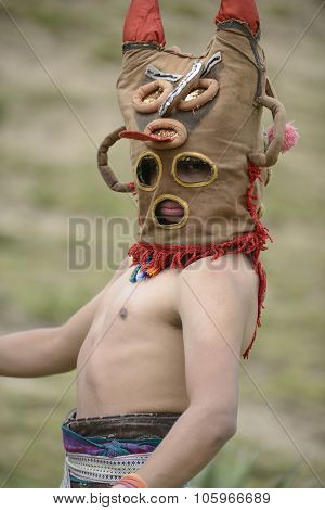 Man in mask celebrating solstice holiday.