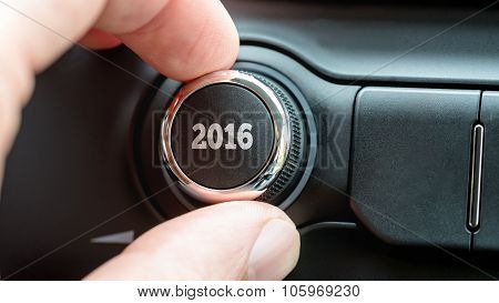 Man Turning A Dial Or Electronic Control Knob With The Date 2016 On The Top