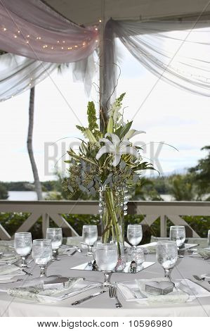 Table Setting With Flowers And Open Window