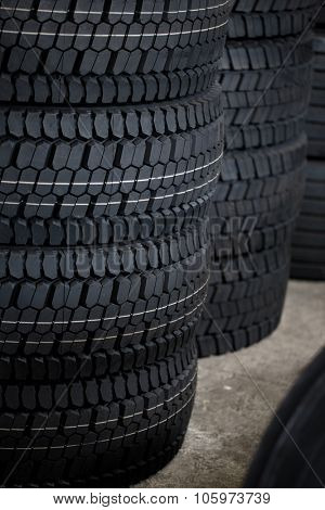 Stack of car tires on warehouse close up